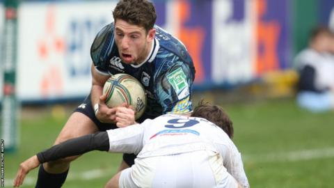 Cardiff Blues wing Alex Cuthbert takes on Montpellier scrum-half Benoit Paillaugue in the Heineken Cup