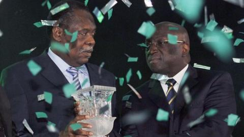 Issa Hayatou (left) and Jacques Anouma (right)