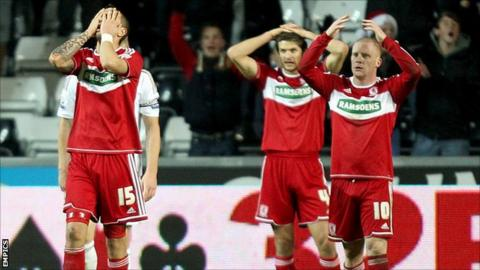 Middlesbrough players dejected after Swansea score