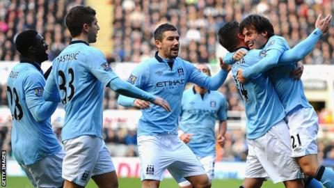 Manchester City players celebrate Javi Garcia's goal at Newcastle