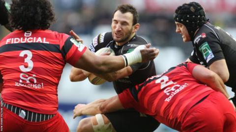 Ospreys' Joe Bearman is tackled by Toulouse's Census Johnston and Gary Botha during the Heineken Cup Pool 2 clash at the Liberty Stadium.