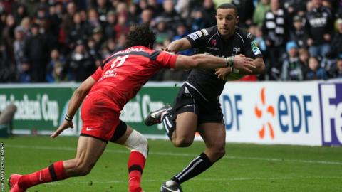 Ospreys wing Eli Walker escapes the tackle of Toulouse's Yoann Huget to cross for a second half try for the home side.