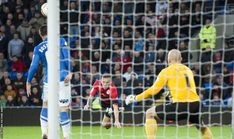 Craig Bellamy heads towards goal as Championship leaders Cardiff City hosted bottom side Peterborough United.