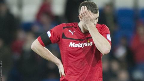 Ben Turner reacts after the final whistle as Peterborough win 2-1 to end Cardiff's 100% home record this season