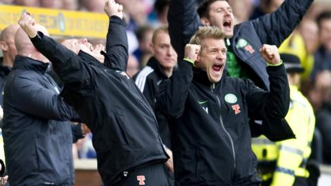 Celtic manager Neil Lennon and assistant Johan Mjallby celebrate as their team clinch the Scottish Premier League title at Rugby Park with a 6-0 win over Kilmarnock