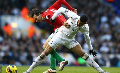 Swansea City striker Michu battles for the ball with Tottenham midfielder Sandro during the Premier League game at White Hart Lane.