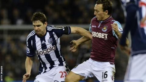 West Brom midfielder Zolten Gera (left) and West Ham midfielder Mark Noble