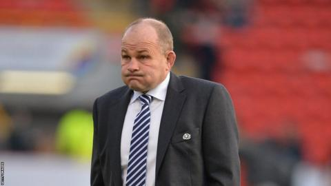 Scotland head coach Andy Robinson cuts an exasperated figure after the defeat by Tonga at Pittodrie