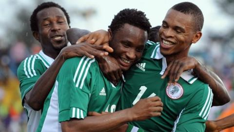 Nigeria celebrate during their victory over Liberia