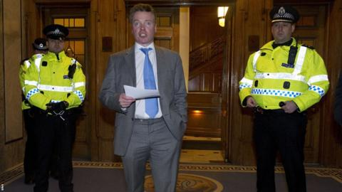 Rangers owner Craig Whyte announces to fans gathered at the main entrance to Ibrox Stadium that the club is likely to go into administration