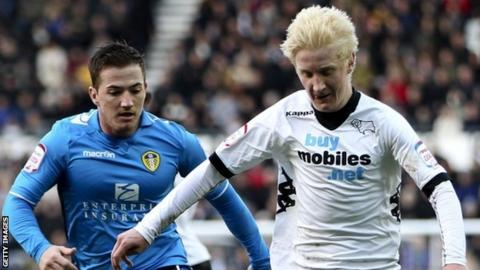 Will Hughes (right) holds off Ross McCormack of Leeds