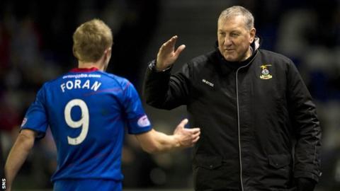 Terry Butcher congratulates captain Richie Foran