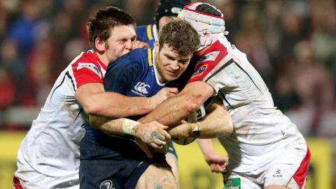Leinster's Gordon D'Arcy attempts to force his way through the challenges of Ulster forwards Rory Best and Iain Henderson