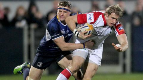 Leinster's Jamie Heaslip tackles Ulster winger Andrew Trimble during the Pro12 match at Ravenhill