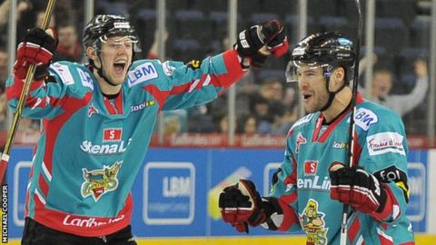 Sam Roberts (right) of the Belfast Giants celebrates with Davy Phillips after scoring the first goal against the Coventry Blaze