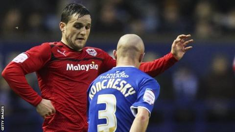 Craig Conway takes on Leicester's Paul Konchesky