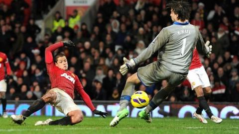 Manchester United's Javier Hernandez beats Newcastle goalkeeper Tim Krul
