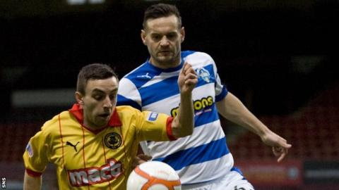 Steven Lawless shields the ball from Morton's Mark McLaughlin