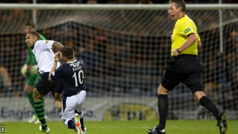 Kelvin Wilson catches John Baird with an elbow during Celtic's win over Dundee