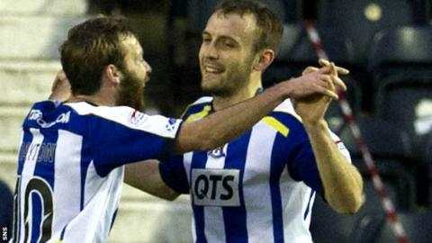 James Dayton and Liam Kelly celebrate the winner against Hearts