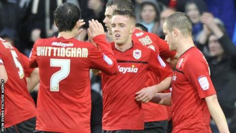 Craig Noone celebrates with teammates after equalising for Cardiff City against Crystal Palace.