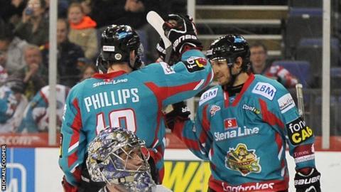 Dave Phillips congratulates goalscorer Kevin Saurette