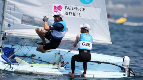 Luke Patience (right), from Aberdeen, and Stuart Bithell celebrate winning the silver medal in the men's 470 sailing on day 14 of the Games at Weymouth