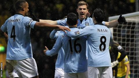 Manchester City celebrate Edin Dzeko (second right) scoring at Norwich