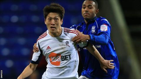 Bolton Wanderers' Chung-Yong Lee and Birmingham City's Robbie Hall
