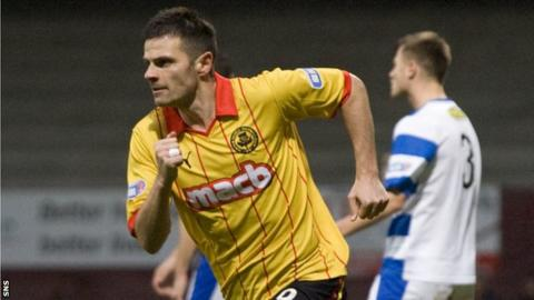 Craig celebrates scoring for Partick Thistle against Morton