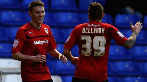 Craig Bellamy congratulates Joe Mason, who scores Cardiff's opener in the Championship at Birmingham