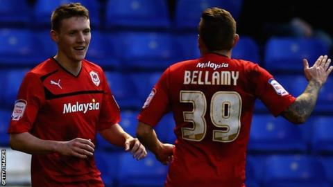 Joe Mason is congratulated by Craig Bellamy
