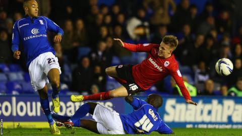 Morgaro Gomis of Birmingham tackles Craig Noone