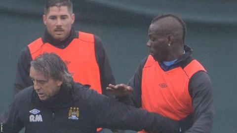 Roberto Mancini (left) and Mario Balotelli (right)