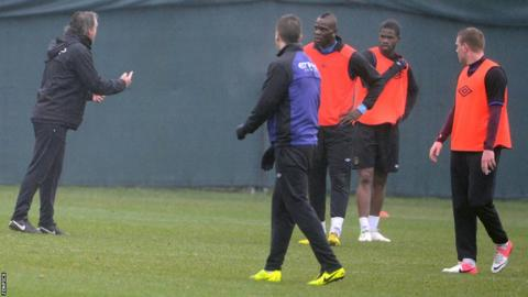 Roberto Mancini (far left) and Mario Balotelli (centre)