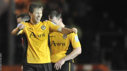 Max Porter celebrates his equaliser at Rodney Parade