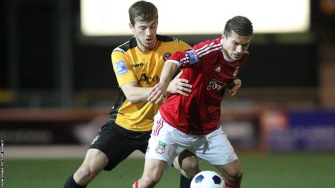 Max Porter and Wrexham's Adrian Cieslewicz battle for the ball