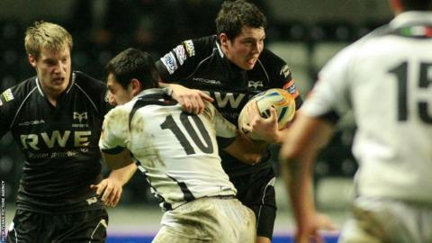 Ospreys' Ross Jones is tackled by Zebre's Paolo Buso
