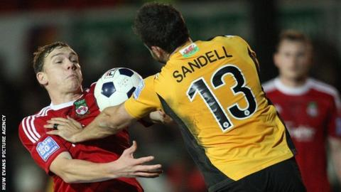 Wrexham's Danny Wright and Newport County's Andy Sandell compete for the ball