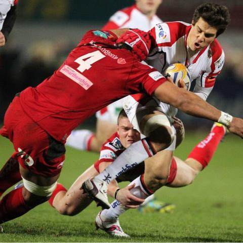 Ulster full-back Adam D'Arcy is tackled by Sione Timani and Tavis Knoyle of Scarlets