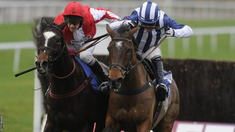 Monbeg Dude (left) beats Teaforthree in the bad-weather delayed 2012 Welsh National at Chepstow