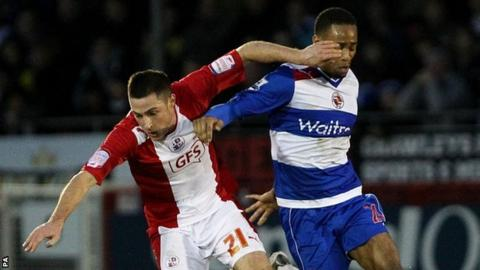 Crawley's Mike Jones is challenged by Reading's Shaun Cummings