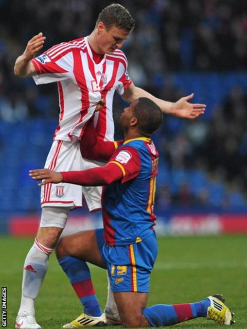 Crystal Palace's Welsh striker Jermaine Easter (right) clashes with Stoke City's German defender Robert Huth as the sides draw 0-0 in the FA Cup third round