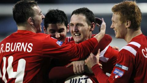 Portadown debutant Gary Twigg is congratulated on scoring the goal which earned a 1-0 win over Donegal Celtic