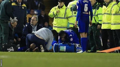 Will Packwood is stretchered off