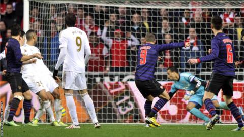 Arsenal forward Lukas Podolski equalises against Swansea