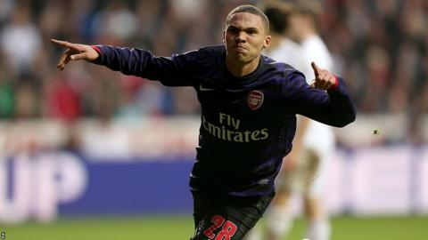 Kieran Gibbs celebrates after giving Arsenal a 2-1 lead at Swansea