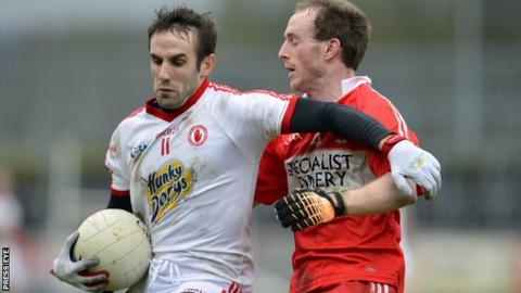 Tyrone's Mark Donnelly battles with Derry's Ciaran Mullan at Healy Park