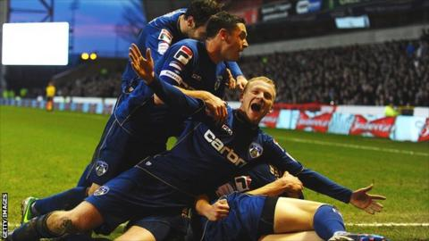 Oldham celebrate a goal during their FA Cup victory at Nottingham Forest