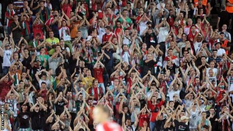 Hungarian fans chanting during a friendly football match between Hungary and Israel